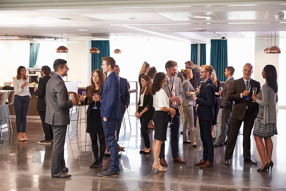Photo of business professionals talking at a networking reception